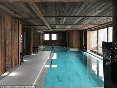 With marble flooring and an indoor pool, the chalet has plenty of room for family or guest...