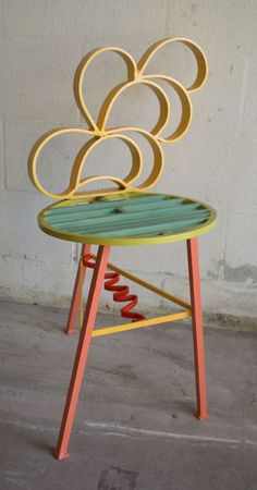A colorful solid metal piece of art furniture. Made from scrap 100% aluminum. Painted and clear coated. Signed and dated by the artist 24 length x 16 wide