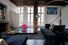 love the pink little chair with the black couch