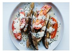 Grilled eggplant and tomatoes with ginger-miso dressing.
