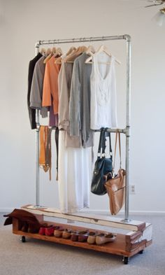 Cool idea for additional storage if you have a small closet or a really big one with extra space. I really like the shoe rack underneath. The shoes are easily movable with the rack and organized. Keeps them from piling in a mess on the flo Standing Closet, Ideas Para Organizar, Closet Rod, Ideas Hogar, Pipe Furniture, Home Organization, Home Projects, Shelving, House Design