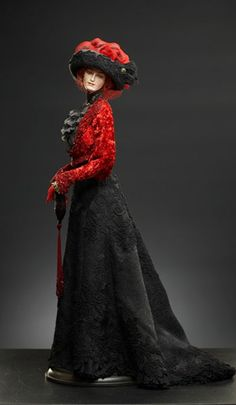 Rebecca doll by Alexandra Koukinova  Promenade suit the beginning of 20 centuries (1908)   The jacket is made of silk velvet, decorated by laces and beads (a mix of antiquarian and modern elements).     The blouse is made of 2 layers of natural silk fabric. The collar and the insert are made of antiquarian laces. Silk skirt is decorated with velvet applique work.     The jewelry - rings, bracelets and earrings with semiprecious stones, srtasses and pearls are made by a special order