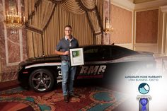 Riley Schroeder, Vice President of Sales and Marketing for Landmark Home Warranty, accepts the award for Landmark as the 22nd fastest growing company in Utah.
