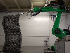 Introduced by Platt Boyd, Branch Technology's customized Kuka robotic arm is sliding on a 10-meter-long rail system to 3D print ABS walls for the company's own exhibition booth. At 25 feet wide by 58 feet long, this is the world's largest freeform 3D printer.