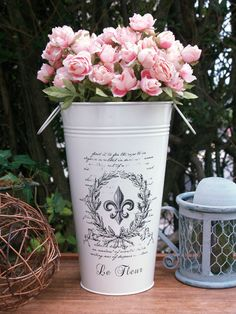 Pink roses in French fleur de lis bucket!!  (Is this me or what?  Roses...and the color pink...and a fleur de lis....in a vintage shabby bucket...oh, my)!!