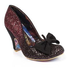 Add a touch of magic to your outfit with Nick of Time! This Dorothy inspired high heel featuring ombre glitter uppers will bring a sprinkle of sparkle in to your life. A large bow on the toe provides a perfectly pretty finish to this popular style.