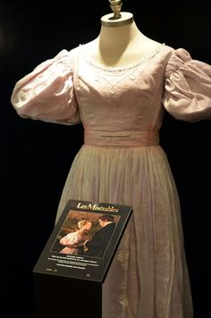 The wedding gown worn by Amanda Seyfried as Cosette, in the film adaption of the Broadway musical Les Miserables, based on the novel by Victor Hugo. Costume design by Paco Delgado.
