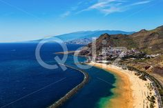 Qdiz Stock Photos | View to coast or shore of Atlantic ocean and beach,  #aerial #Atlantic #background #beach #blue #breakwater #Canary #City #coast #coastline #Cruz #island #landscape #LasTeresitas #mountain #nature #ocean #playa #rock #Santa #sea #shore #sky #Spain #spring #summer #Teide #Tenerife #view #volcano #water #yellow