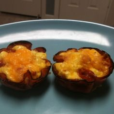 """My own low carb ham and egg breakfast """"muffin"""" : 1 egg beaten with a slice of crumbled bacon, salt and pepper, place 2 slices , doubled up, in each greased muffin tin cup, (i use honey ham) fill your ham """"muffin cups"""" with the egg mix, one egg will do 2 muffins, top with a lil cheddar and bake @375 for 20 min"""