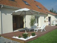 terrasse bois sur dalle ciment + retenir avancée pour coin rangement par exemple