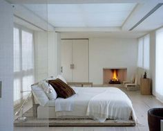 minimal but cozy bedroom with fireplace