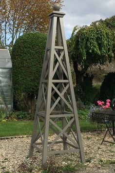 The Regent Obelisk by Oxford Planters was designed to stand proud in the finest or gardens as a decorative pieve in the winder and a stunning plant support for your climbers throughout the summer months. Each obelisk is made to order. Obelisk Trellis, Diy Trellis, Garden Trellis, Outdoor Projects, Garden Projects, Garden Crafts, Garden Art, Garden Windmill, Garden Statues