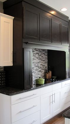Two tone kitchen cabinets. White cabinets and darker wood cabinets. Craftsman kitchen. Grey walls and linear backsplash