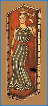 Figura de una muchacha cimbreante tocada con corona, que porta en el dorso de la mano izquierda un pájaro a la altura de la cabeza. Viste brial encordado de color azul con cinturón rojo, y sobre él la cota o pellote castellano con hendiduras cortadas para que se vea el brial debajo. Catedral de Teruel