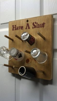 This is a pine shot glass hanging display. It holds 12 of your favorite shot glasses. It measures 10 1/2 inches high by 9 1/4 inches wide. It is made from 3/4 inch pine and has 12 poplar pegs for your shot glasses. It should hold most shot glasses. It is stained in oak and has a rustic look