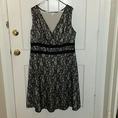 Beautiful dress Black lace dress with a nude undertone. Great for a wedding or a night out. Easy to dress up or down. Stretchy and comfy to wear! Very figure flattering! It goes over the knee a couple of inches for me. Dresses