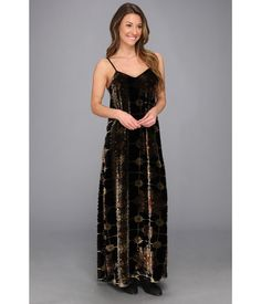 Groovy.. Superbly soft velvet constructs this stylish maxi dress.. Vibrant allover pattern for an e...