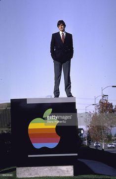 News Photo : Steve Jobs atop Company sign outside Apple...