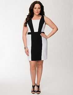 Reimagining the classic pairing of black and white, our curve-flaunting sheath dress features pieced paneling to highlight all your assets. This confidence-boosting silhouette was made to flatter with tapered colorblocking and a banded waist, plus wide tank straps and a square neckline. Hidden side zipper with hook & eye closure. Fully lined. lanebryant.com