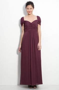 The cap sleeves and wide neckline on this gorgeous wine-colored chiffon gown makes me think of innocent romance and young love.