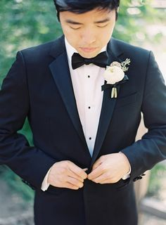 Classic black tux with white shirt and white boutonniere. #grooms #fashion