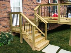 ACQ pressure treat pine wood #deck steps with @Deckorators Railing and Accessories Railing and Accessories black aluminum balusters.