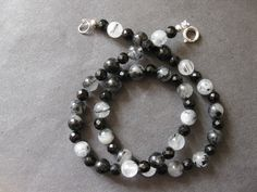 Rutilated quartz and faceted onyx necklace.
