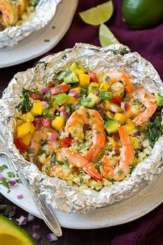 Shrimp And Couscous Foil Packets With Avocado-mango Salsa With Olive Oil Cooking Spray, Spinach, Couscous, Chicken Broth, Salt, Freshly Ground Black Pepper, Large Shrimp, Fresh Lime Juice, Olive Oil, Chopped Cilantro, Garlic Cloves, Ground Cumin, Mango, Avocado, Tomatoes, Purple Onion