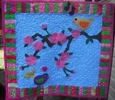 Love Blossoms Again for two little chickadees in a cherry blossom tree. You can use applique and fusible interfacing to create this precious block. The beautiful pink cherry blossoms contrast with the branch in this tree applique pattern. Star Quilt Patterns, Applique Patterns, Craft Patterns, Sewing Patterns, Small Quilts, Mini Quilts, Baby Quilts, Quilting Projects, Quilting Designs