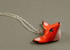 Orange Fox Head Necklace - Hand Sculpted Polymer Clay - Silver Tone. $25.00, via Etsy.