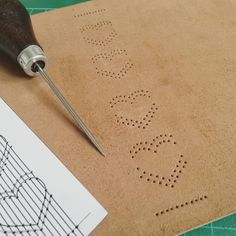 poking holes by Dani Fox - heart bookbinding