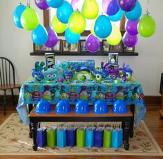 Monster Inc Birthday Party Table.  Balloons..No helium? Hang Balloons upside down!  Please see our printed balloons at www.balloon-printing.com