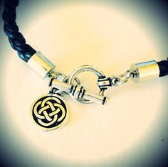 St. Patty's is a comin'! Celtic knot braided leather bracelet from JewelryByMaeBee on Etsy. $24