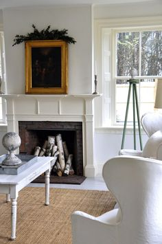 Terry John Woods - white /cream simplicity...serene.  Love fireplace with birch logs