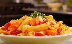 Rigatoni with sea bass, scampi and Italian tomatoes