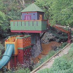 """Okay, well this is expensive, but it's definitely custom made to fit the existing landscape... The designer notes: """"Certain elements are great kid pleasers and I try to always include them: good solid swings, fast slides, rock climbing, jailbars, secret escapes, fireman's pole, rope net ladder, and a high-up place"""""""