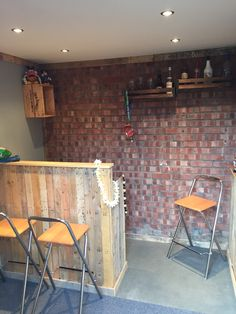 My garage after!  Home bar/ Man cave. Bar and wainscoting done using reclaimed pallets