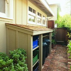 This simple lean-to structure is perfect for hiding trash cans, recycling bins, and more. Get the DIY from Sunset. I would love to build one of these to hid e the trash cans. Weekend Projects, Backyard Projects, Outdoor Projects, Garden Projects, Home Projects, Backyard Ideas, Recycling Storage, Recycling Center, Recycling Station