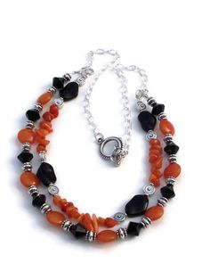 2 strand necklace.  Orange dyed quartzite chips and lentils.  Black glass beads.  Halloween.  Silver tone chain and toggle clasp.