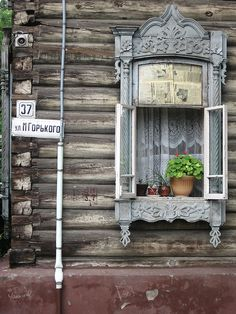 "In Tomsk Siberia you find wooden houses, like those out of a famous Russian fairytale with windows bordered with elaborately carved wooden ""lace""."