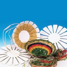 Instead of buying a 12-pack kit here, maybe I could cut out circle in cardboard in differing sizes and buy raffia from Nashville Wraps in our colors for the wedding.