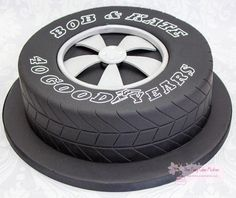 """This cake was made for a couple who were keen motor enthusiasts to celebrate their 40th wedding anniversary. It was their idea to use the """"GoodYear"""" tyre – I thought it was genius ! Thanks for looking !"""