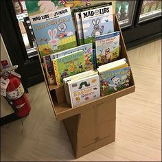 Hopping Good Easter Books Pedestal Display – Fixtures Close Up Easter Books, Easter Eggs, Store Fixtures, Pedestal, Display, Billboard