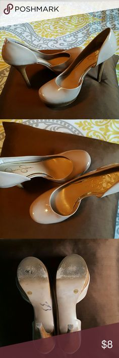 JESSICA SIMPSON patent leather heels Very comfortable tan patent leather heels. 1.5 wooden platform with 3.5/4 inch heels. Very good condition with a small black mark on one of the heels, sticker residue on the inside of one shoe, and heel pads in both. A little worn on the bottom. No trades or PayPal. Jessica Simpson Shoes Heels