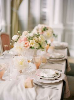 Love the scalloped dishes, the peach glasses and pale yellow/peach/white color scheme