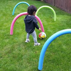 Make a pool noodle obstacle course. Use wooden skewers to attach the noodles to the ground.