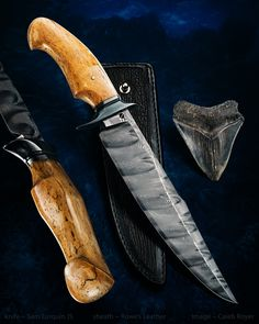 """Sam Lurquin Shark Fighter. 8 1/2"""" BadassSam Damascus blade, Megalodon shark tooth fossil handle. Rowe leather sheath. Honestly one of the most beautiful knives I've ever seen."""