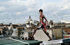 Christy Turlington on the Paris rooftops in Christian Lacroix, shot by Arthur Elgort.