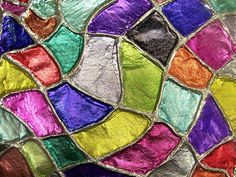 Draw a design. Glue yarn on lines. dry. Spray adhesive and lay foil over the top, press the foil down around their yarn pieces and use sharpies.    Lastly, they used colored Sharpies to color the recessed