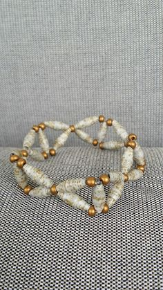 Golden paper bead bracelet by MagdaCrafts on Etsy, £8.50